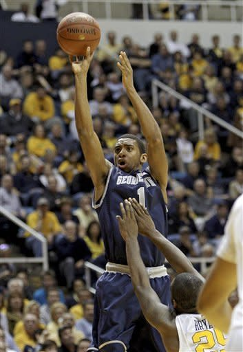 Georgetown's Hollis Thompson (1) shoots over West Virginia's Darryl Bryant during the first half of an NCAA college basketball game at WVU Coliseum in Morgantown, W.Va., on Saturday, Jan. 7, 2012. (AP Photo/David Smith)