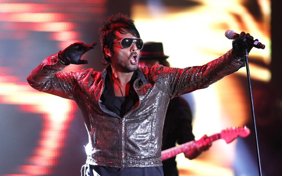 Chilean singer Beto Cuevas performs during the 55th International Song Festival in Vina del Mar city, about 121 km (75 miles) northwest of Santiago, February 26, 2014. REUTERS/Eliseo Fernandez (CHILE - Tags: ENTERTAINMENT)