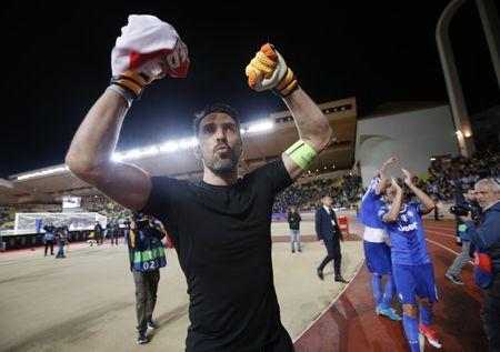 Juventus' Gianluigi Buffon celebrates after the match