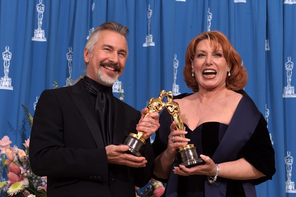 Rick Baker and Gail Ryan, winners of the Oscar for Achievement in Makeup for their work on 'The Grinch' at the 73rd Annual Academy Awards on March 25, 2001. (Credit: Kevin Winter/Getty Images)