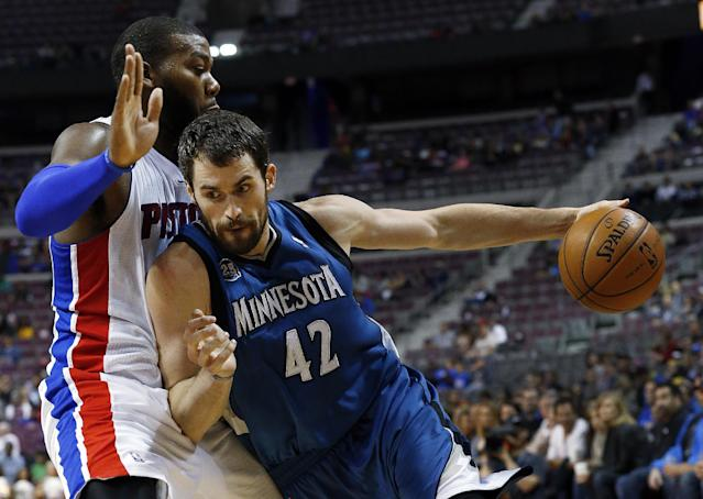 Minnesota Timberwolves power forward Kevin Love (42) drives against Detroit Pistons center Greg Monroe in the first half of their preseason NBA basketball game in Auburn Hills, Mich., Thursday, Oct. 24, 2013. (AP Photo/Paul Sancya)