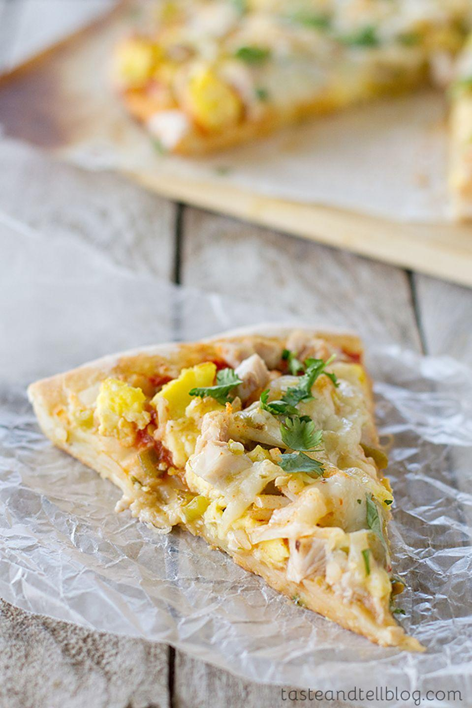"""<p>Green chiles, taco seasoning, and your favorite salsa are a delicious combo, but it's the extra turkey that turns out to be the star on this southwestern slice.</p><p><strong>Get the recipe at <a href=""""https://www.tasteandtellblog.com/mexican-turkey-breakfast-pizza/"""" rel=""""nofollow noopener"""" target=""""_blank"""" data-ylk=""""slk:Taste and Tell Blog"""" class=""""link rapid-noclick-resp"""">Taste and Tell Blog</a>.</strong></p><p><a class=""""link rapid-noclick-resp"""" href=""""https://www.amazon.com/Pizzacraft-Round-ThermaBond-Baking-Pizza/dp/B005IF2ZNM?tag=syn-yahoo-20&ascsubtag=%5Bartid%7C10050.g.2144%5Bsrc%7Cyahoo-us"""" rel=""""nofollow noopener"""" target=""""_blank"""" data-ylk=""""slk:shop pizza stones"""">shop pizza stones</a></p>"""