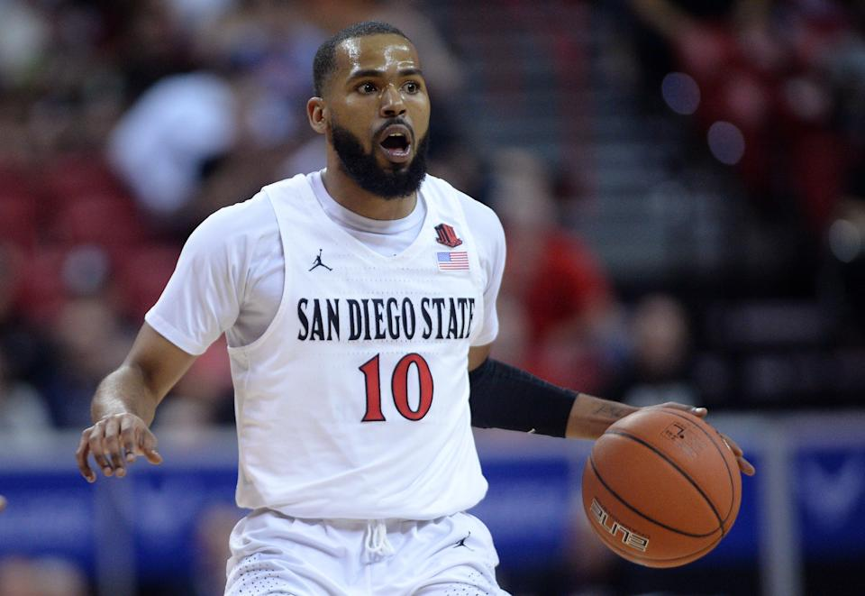 Mar 6, 2020; Las Vegas, Nevada, USA; San Diego State Aztecs guard KJ Feagin (10) gestures as he dribbles against the Boise State Broncos during the first half of a Mountain West Conference tournament game at Thomas and Mack Center.