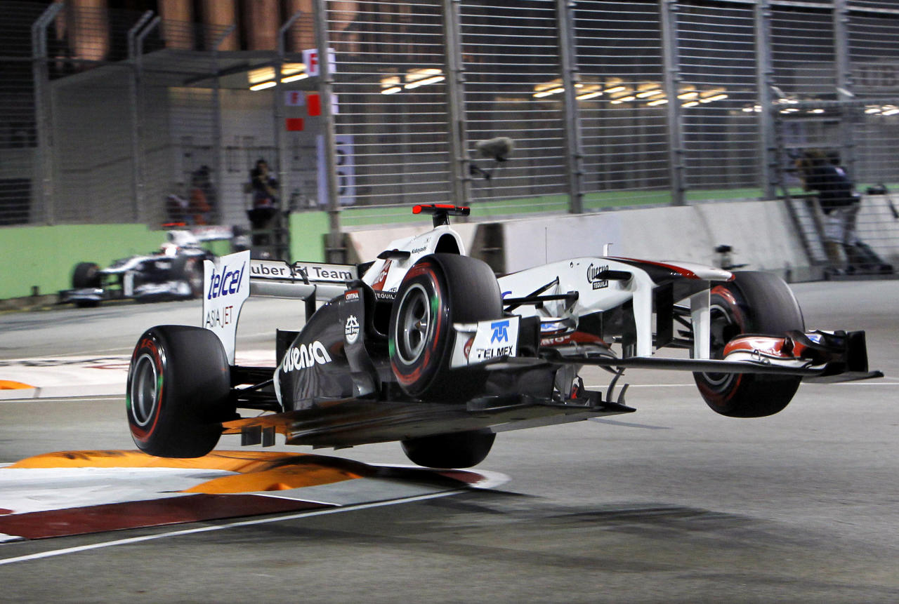 Sauber driver Kamui Kobayashi of Japan loses a control prior to a crash on the wall during the qualifying session for Sunday's Singapore Formula One Grand Prix on the Marina Bay City Circuit in Singapore, Saturday, Sept. 24, 2011. (AP Photo/Terence Tan)