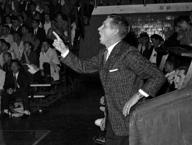 FILE - in this Feb. 24, 1959 file photo, Mississippi State's coach Babe McCarthy sounds off from a bench during a college basketball game against Tulane University in New Orleans. Loyola-Chicagos run to the Sweet 16 is resurfacing memories of 1963, when it won the NCAA Tournament on an overtime tip-in. But even more culturally significant was the Ramblers 1963 regional semifinal against Mississippi State, a game that was in danger of not being played because of Mississippis informal law barring its schools from playing against racially integrated teams. (AP Photo/File)