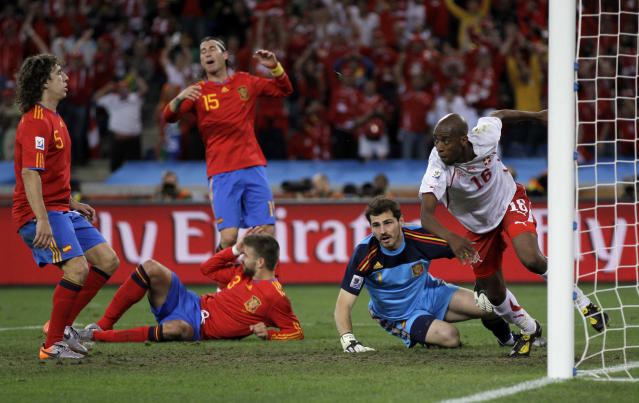FILE - This is a Wednesday, June 16, 2010. file photo of Switzerland's Gelson Fernandes, right, as he celebrates after scoring during the World Cup group H soccer match between Spain and Switzerland at the stadium in Durban, South Africa. From left, Spain's Carles Puyol, Spain's Gerard Pique, on the ground, Spain's Sergio Ramos and Spain goalkeeper Iker Casillas. (AP Photo/Julie Jacobson, File)