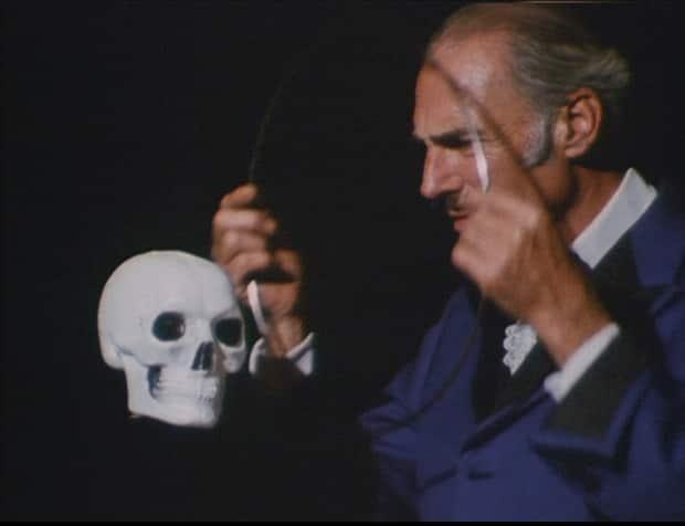 In this still from a CBC documentary, Leon Mandrake performs an illusion in which he makes a skull float in the air, much like he did in front of his son's unsuspecting date years ago.