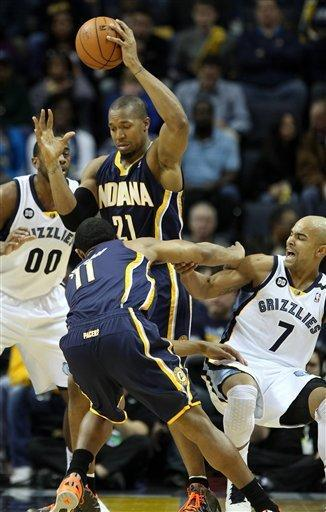 Indiana Pacers forward David West (21) and guard Orlando Johnson (11) get trapped by Memphis Grizzlies guard Jerryd Bayless (7) and forward Darrell Arthur (00) in the first half of an NBA basketball game on Monday, Jan. 21, 2013, in Memphis, Tenn. (AP Photo/Lance Murphey)