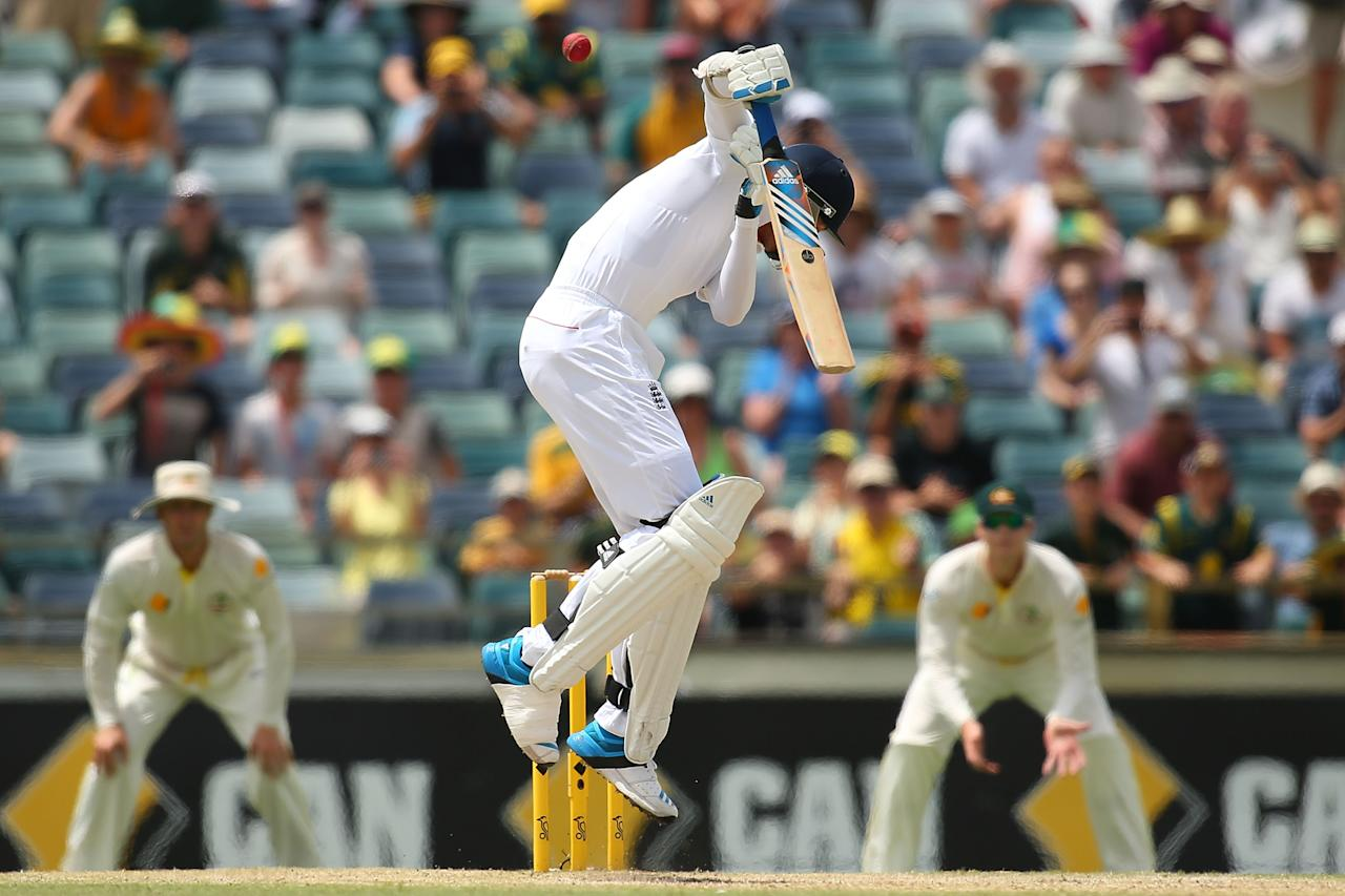 PERTH, AUSTRALIA - DECEMBER 17: Stuart Broad of England fends off a high delivery from Mitchell Johnson of Australia during day five of the Third Ashes Test Match between Australia and England at the WACA on December 17, 2013 in Perth, Australia.  (Photo by Paul Kane/Getty Images)