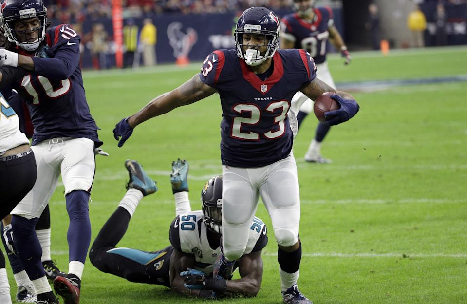 Houston Texans running back Arian Foster (23) eludes Jacksonville Jaguars outside linebacker Telvin Smith (50) to score a touchdown during the first half of an NFL football game, Sunday, Dec. 28, 2014, in Houston. (AP Photo/David J. Phillip)