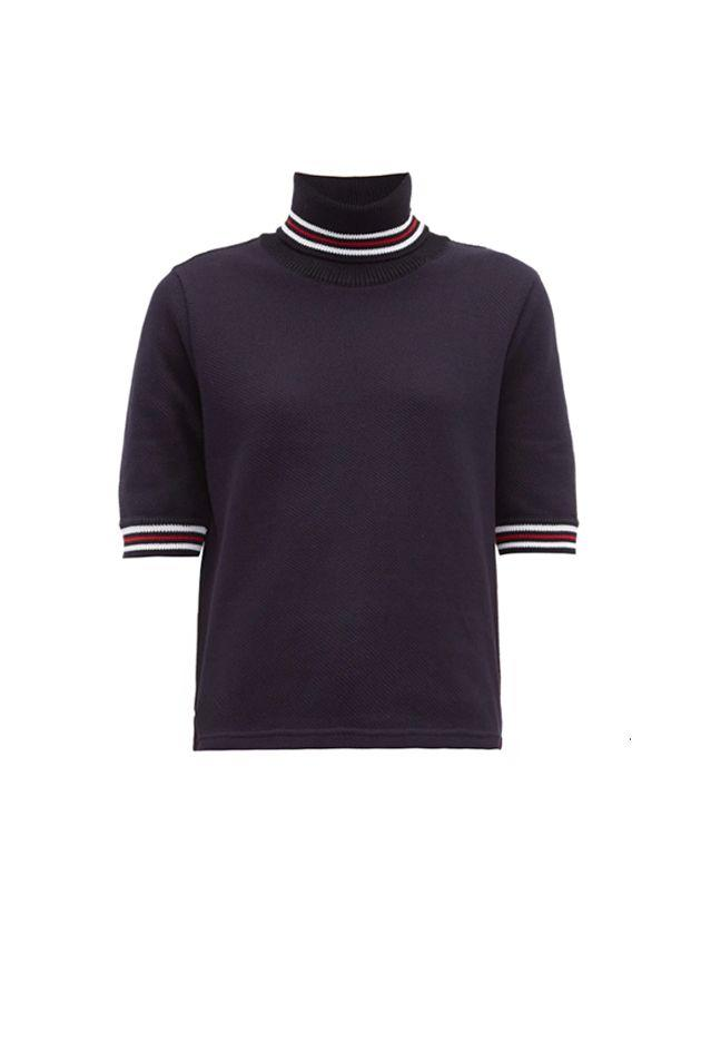 """<p>When hitting the streets for celebrations, opt for a short-sleeve knit top featuring the colors of the French flag. </p><p><em>Striped cotton-piqué roll-neck T-shirt, $707 </em></p><a class=""""body-btn-link"""" href=""""https://go.redirectingat.com?id=74968X1596630&url=https%3A%2F%2Fwww.matchesfashion.com%2Fproducts%2FThom-Browne-Striped-cotton-piqu%25C3%25A9-roll-neck-T-shirt-1280585&sref=http%3A%2F%2Fwww.crfashionbook.com%2Ffashion%2Fg28353991%2Fbastille-day-shopping-guide-france%2F"""" target=""""_blank"""">SHOP</a>"""