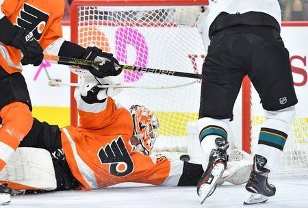 Oct 9, 2018; Philadelphia, PA, USA; San Jose Sharks left wing Evander Kane (9) scores a goal past Philadelphia Flyers goaltender Brian Elliott (37) during the first period at Wells Fargo Center. Mandatory Credit: Eric Hartline-USA TODAY Sports