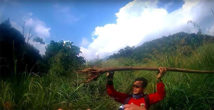 One of the bikers found the stick the bald man was carrying. Photo: Youtube/Fredography