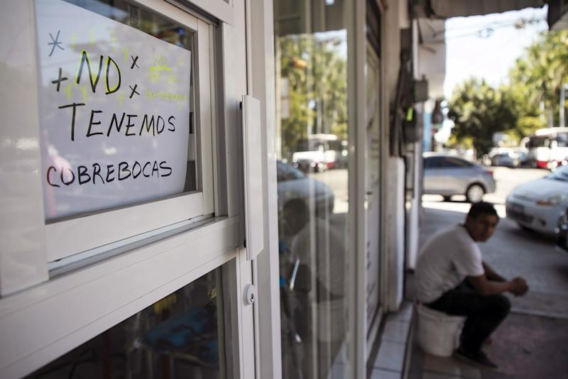 View of a sign announcing that protective face masks are sold out, at a shop in Culiacan, Sinaloa state, on February 28, 2020 as the new coronoavirus, COVID-19, spreads worldwide. - Mexico's Health Ministry confirmed the country's first cases of coronavirus on Friday, saying two men who recently returned from Italy tested positive for the virus. (Photo by RASHIDE FRIAS / AFP) (Photo by RASHIDE FRIAS/AFP via Getty Images)