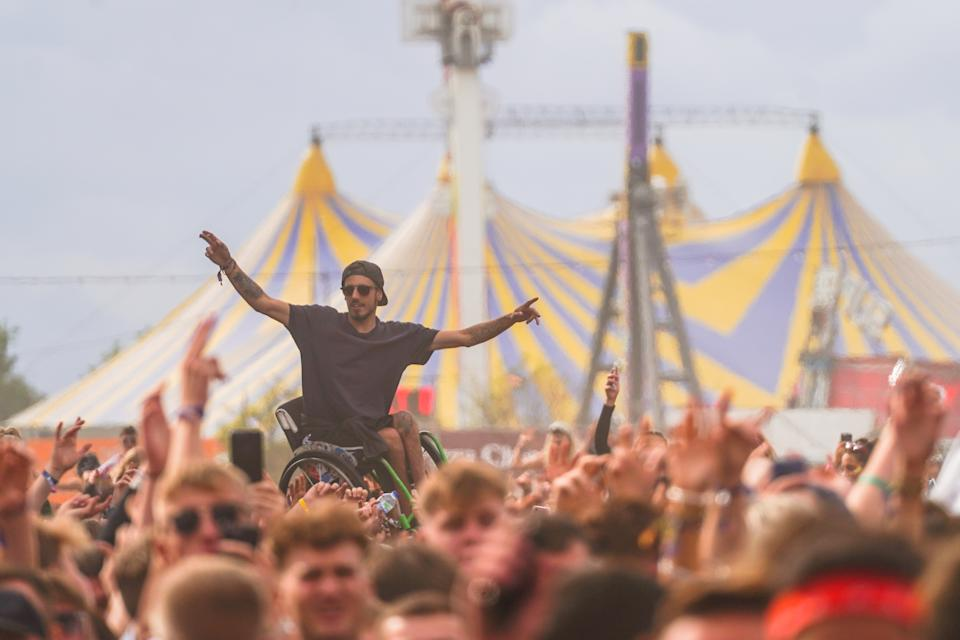 A festival goer in a wheelchair being held aloft in the crowd in front of the Main Stage at the 2018 Reading Festival. Photo date: Friday, August 24, 2018. Photo credit should read: Richard Gray/EMPICS Entertainment