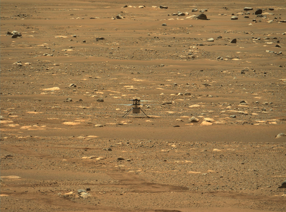 """<span class=""""caption"""">NASA's Ingenuity Mars Helicopter on its first flight, captured by cameras aboard NASA's Perseverance Mars rover on April 19, 2021.</span> <span class=""""attribution""""><span class=""""source"""">(NASA/JPL-Caltech/ASU)</span></span>"""