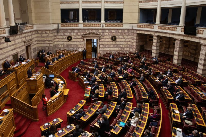 Greek PM Mitsotakis addresses lawmakers during a parliamentary session on revelations of abuse in arts and sports, in Athens