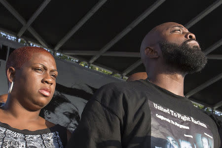 Cal Brown (L) and Michael Brown Sr., stepmother and father of fatally shot Michael Brown, attend the Peace Fest rally in St. Louis, Missouri August 24, 2014. REUTERS/Adrees Latif
