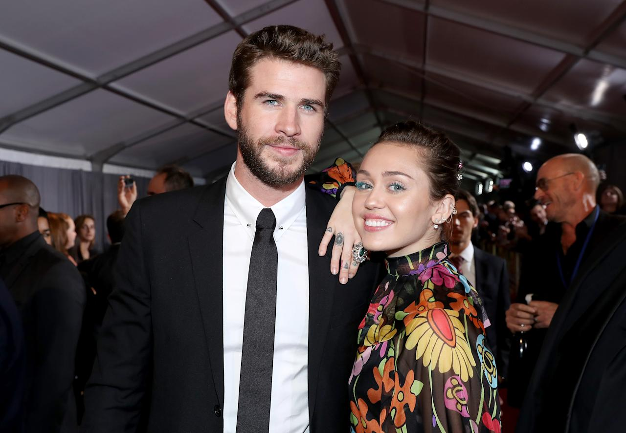 <p>The pair made their first red carpet appearance together since August 2013. Cyrus wore a sheer printed dress with blue lashes to match her beau's eyes. (Photo: Getty Images) </p>