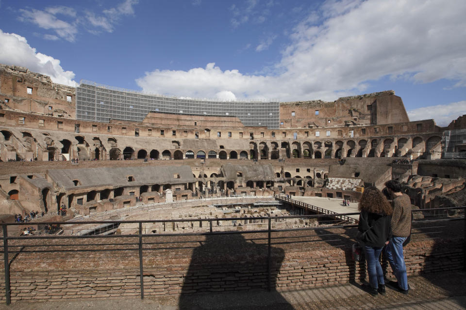 Tourists visit the Colosseum, in Rome, Saturday, March 7, 2020. With the coronavirus emergency deepening in Europe, Italy, a focal point in the contagion, risks falling back into recession as foreign tourists are spooked from visiting its cultural treasures and the global market shrinks for prized artisanal products, from fashion to design. (AP Photo/Andrew Medichini)