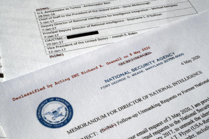 """A declassified document with names of President Barack Obama administration officials who made requests for unmasking of Michael Flynn's name is photographed Wednesday, May 13, 2020. In 2016, Obama administration officials received intelligence reports that were concerning, but incomplete. Surveillance of Russia's ambassador to the U.S. revealed he had interacted with an unnamed American who may have been undercutting efforts to pressure Vladimir Putin's government. Using a common process known as """"unmasking,"""" they asked intelligence agencies to reveal the American's name. It was Flynn, an adviser to President-elect Donald Trump. The document was declassified by acting Director of National Intelligence Richard Grenell. (AP Photo/Jon Elswick)"""