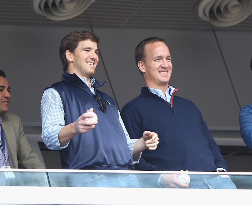 NEW YORK, NY - MAY 04:  Eli Manning of the New York Giants and Peyton Manning of the Denver Broncos appear at the game between the New York Yankees and the Tampa Bay Rays  on May 4, 2014 in the Bronx borough of New York City.  (Photo by Al Bello/Getty Images)