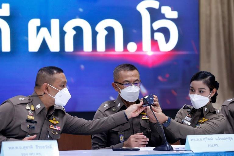 In a press conference last month, Thitisan Utthanaphon answered questions from the media over a mobile phone held up to a microphone (AFP/Krit Phromsakla Na SAKOLNAKORN)