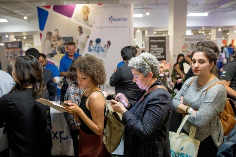 FILE PHOTO: Job seekers and recruiters gather at TechFair in Los Angeles