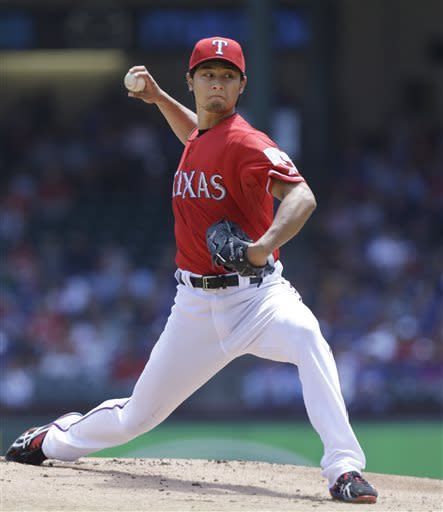Texas Rangers starting pitcher Yu Darvish, of Japan, throws during the first inning of a baseball game against the Boston Red Sox, Sunday, May 5, 2013, in Arlington, Texas. (AP Photo/LM Otero)