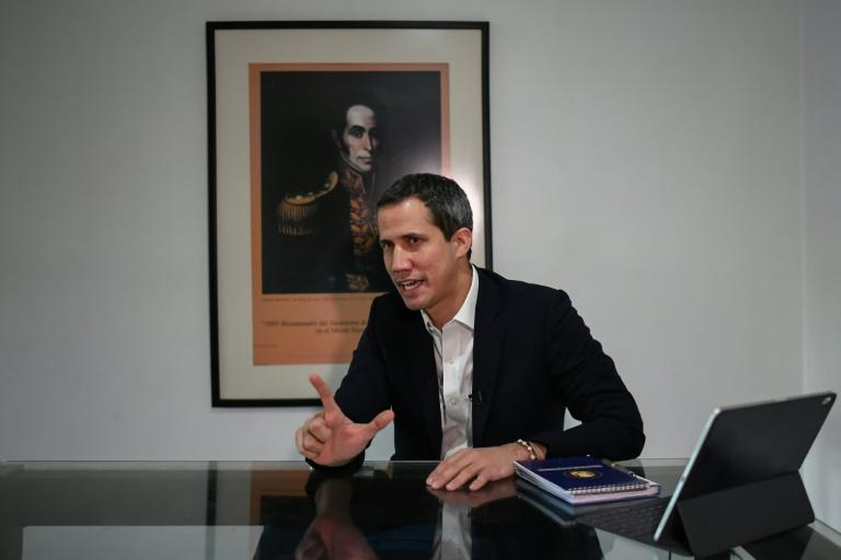 As things stand, Venezuela's presidential election is not due until 2024 but opposition leader Juan Guaido told AFP he wants one 'already in December, as soon as possible' (AFP/Federico PARRA)