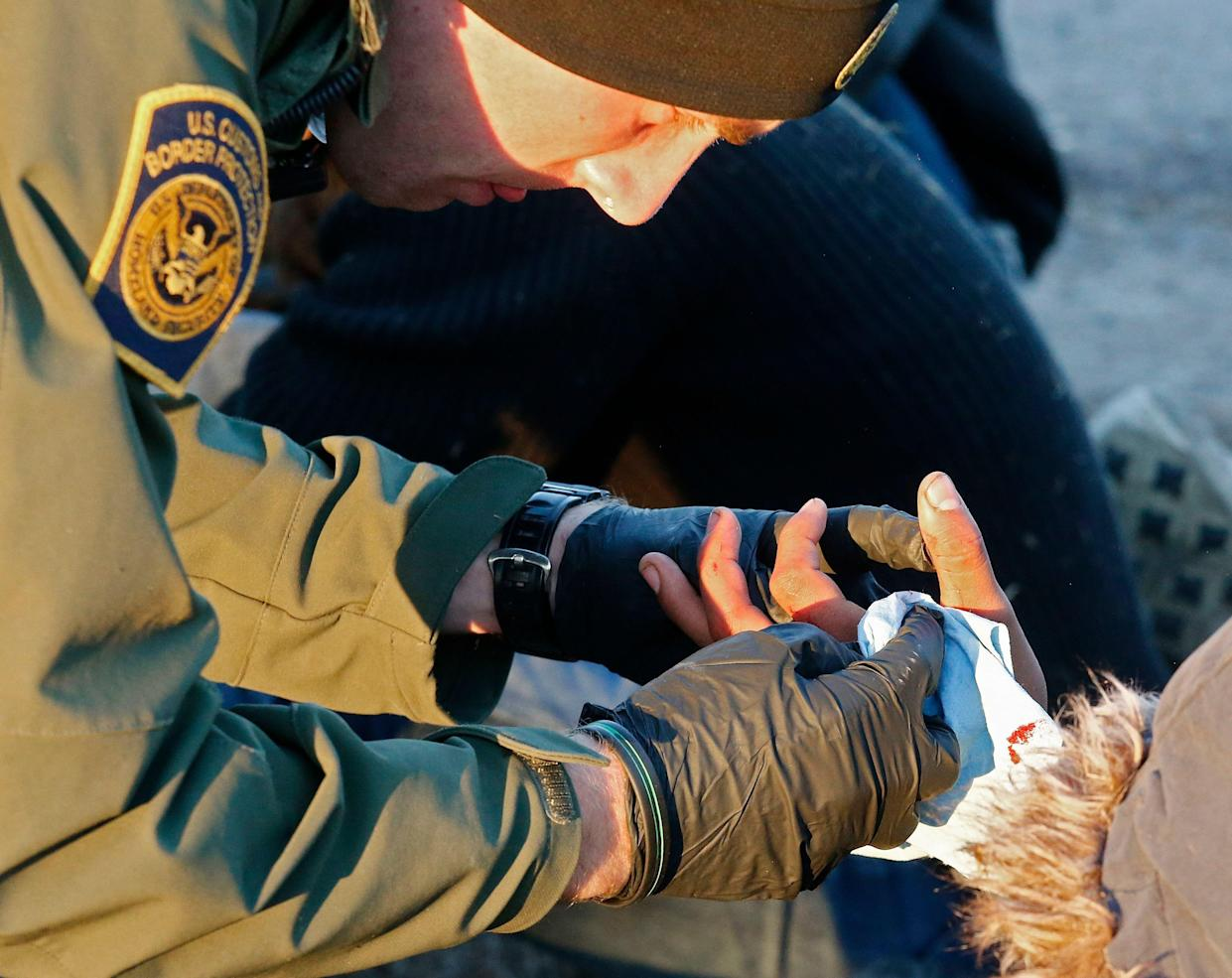 A Border Patrol agent tends to a person suspected of entering the United States illegally near McAllen, Texas. (Photo: Larry W. Smith/EPA-EFE/Shutterstock)