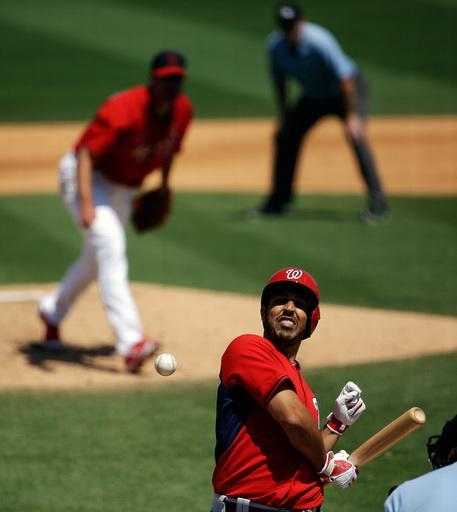 Washington Nationals' Gio Gonzalez, right, is hit by a pitch from St. Louis Cardinals starting pitcher Adam Wainwright, left, in the fifth inning of an exhibition spring training baseball game, Wednesday, March 26, 2014, in Jupiter, Fla. (AP Photo/David Goldman)