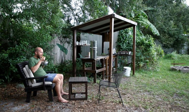 Rob Greenfield lives in someone else's backyard, and has set up an open-air kitchen of sorts