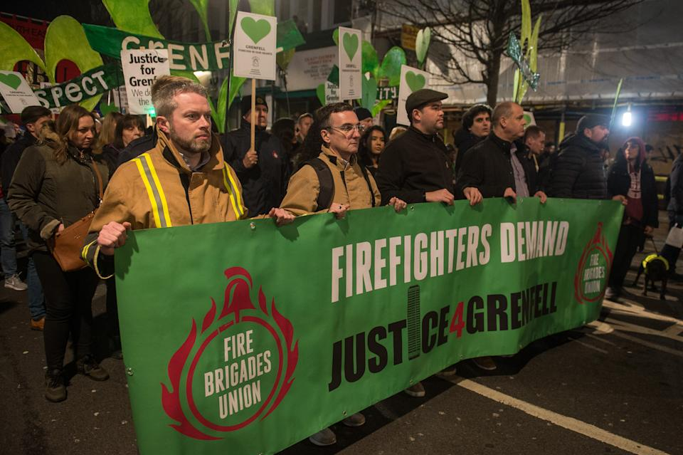 Survivors of the Grenfell fire are joined by fire fighters and supporters for a monthly silent walk to remember the dead and demand justice for the living (Guy Smallman/Getty Images)