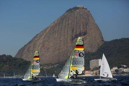 German Olympic team sailors Erik Heil and Thomas Ploessel (5) next to teammates during their training session in the 49er class in Rio de Janeiro, Brazil, July 12, 2016. Picture taken on July 12, 2016.  REUTERS/Bruno Kelly