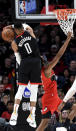 Houston Rockets guard Russell Westbrook, left, blocks the shot of Portland Trail Blazers forward Trevor Ariza, right, during the first half of an NBA basketball game in Portland, Ore., Wednesday, Jan. 29, 2020. (AP Photo/Steve Dykes)