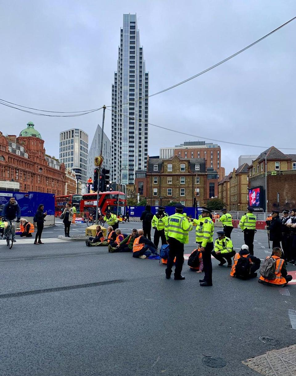 The protesters have blocked Old Street roundabout in central London (@EmbobEast/PA) (PA Media)