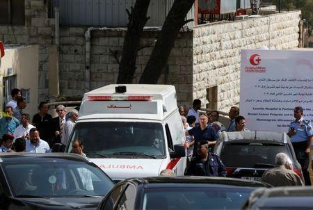 An ambulance transports the body of Jordanian writer Nahed Hattar to a medical facility, after he was shot, in Amman, Jordan, September 25, 2016. REUTERS/Muhammad Hamed