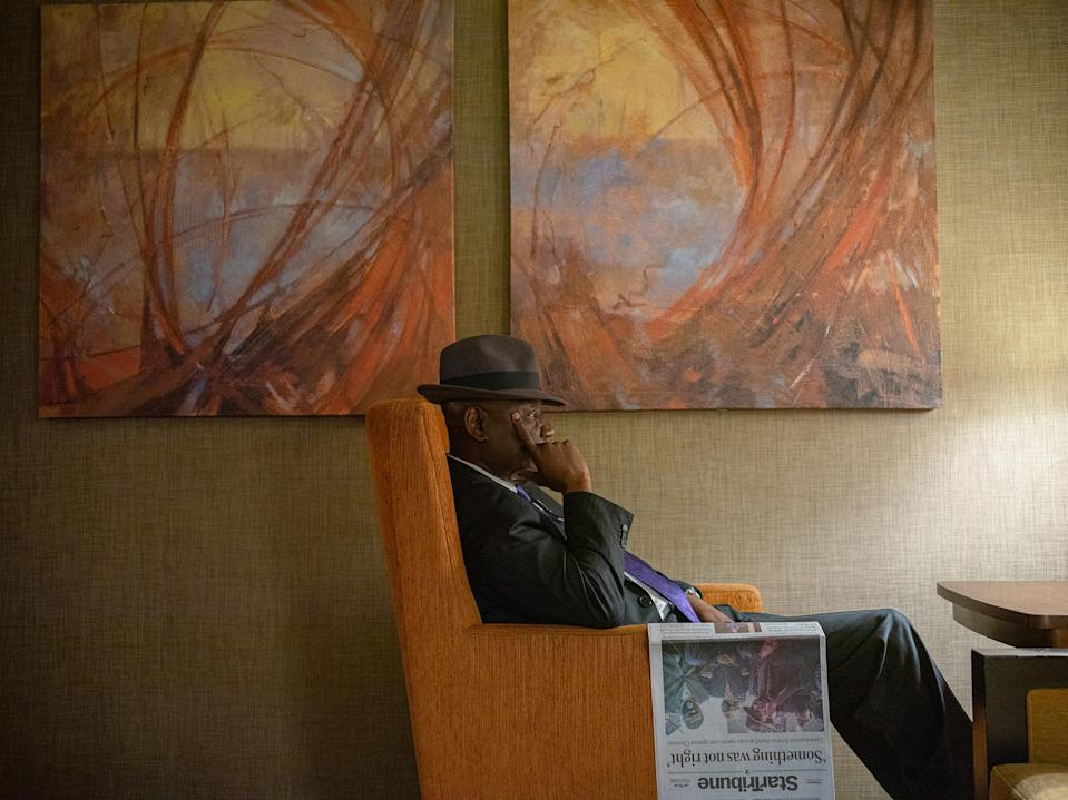"""Crump rests after reading the paper in the lobby of the Westin Hotel in Minneapolis on March 30.<span class=""""copyright"""">Ruddy Roye for TIME</span>"""