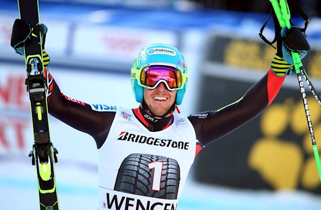 Ted Ligety, of the United States, celebrates in the finish area after winning an alpine ski, men's World Cup super-combined, in Wengen, Switzerland, Friday, Jan. 17, 2014. (AP Photo/Alessandro Trovati)