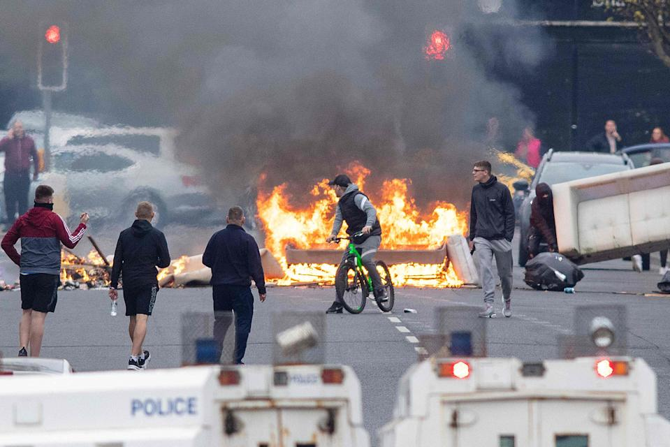<p>Streets burn: unrest in west Belfast yesterday</p> (AFP via Getty Images)