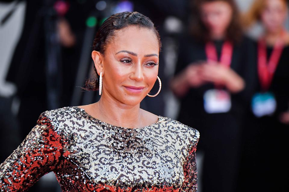 VENICE, ITALY - AUGUST 28: Melanie Brown walks the red carpet ahead of the opening ceremony during the 76th Venice Film Festival at Sala Casino on August 28, 2019 in Venice, Italy. (Photo by Stephane Cardinale - Corbis/Corbis via Getty Images)