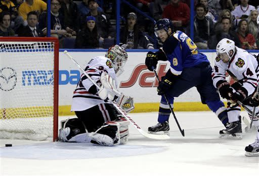 St. Louis Blues' Jaden Schwartz (9) slides the puck past Chicago Blackhawks goalie Carter Hutton (33) for his second goal of the game during the second period of an NHL hockey game, Saturday, April 27, 2013 in St. Louis. (AP Photo/Tom Gannam)