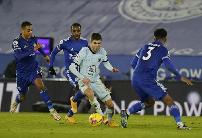 Chelsea's Christian Pulisic, center, tries to dribble past Leicester's Youri Tielemans, left, and Wesley Fofana, right, during the English Premier League soccer match between Leicester City and Chelsea at the King Power Stadium in Leicester, England, Tuesday, Jan. 19, 2021. Leicester City won the match 2-0. (Tim Keeton/Pool via AP)