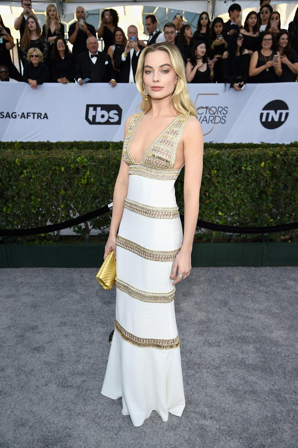 <p>Wearing a white and gold Chanel dress with a clutch from the brand as well. She finished her look off with Giuseppe Zanotti heels.</p>