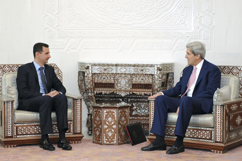 FILE - This April 1, 2010 file photo released by the Syrian official news agency SANA, shows Syrian President Bashar Assad meeting with Sen. John Kerry, D-Mass., President Barack Obama's choice to become the next secretary of state, at al-Shaab presidential palace in Damascus, Syria. Kerry's past words of encouragement for Syrian President Bashar Assad are certain to draw scrutiny at his confirmation hearing for secretary of State as the Mideast ruler's brutal crackdown has plunged the country into months of deadly civil war and turned Assad into a pariah.  (AP Photo/SANA, File) ** EDITORIAL USE ONLY **