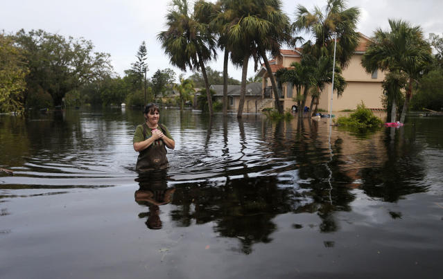 <p><strong>Bonita Springs</strong><br>Kelly McClenthen walks through her flooded neighborhood, as she returns to see the damage to her home in the aftermath of Hurricane Irma in Bonita Springs, Fla., Sept. 11, 2017. (Photo: Gerald Herbert/AP) </p>