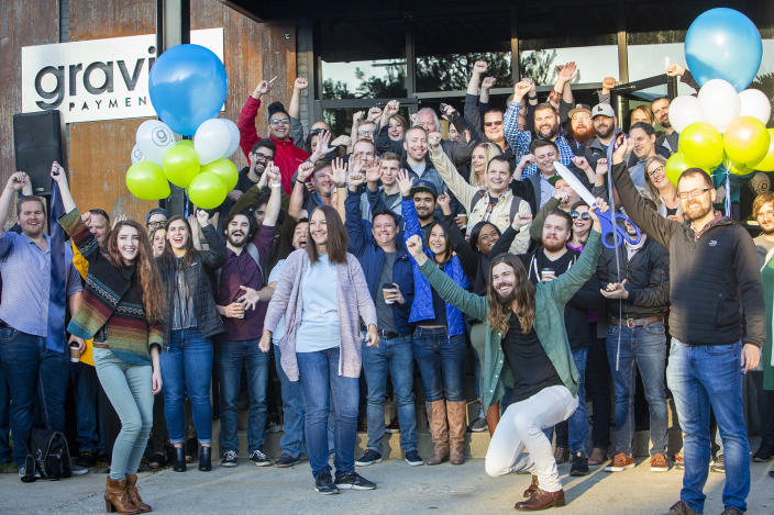 Dan Price, in the green shirt, CEO of Gravity Payments, celebrates the opening of Gravity Payments' new Boise office. Price said he expects to add more workers over time. (Katherine Jones/Idaho Statesman/Tribune News Service via Getty Images)