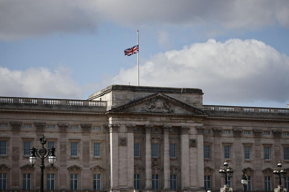 The Union Flag is flown at half-mast from the top of Buckingham Palace in central London, on April 11, 2021, two days after the death of Britain's Prince Philip, Duke of Edinburgh, at the age of 99. - The funeral of Queen Elizabeth II's husband, Prince Philip, will take place next week, Buckingham Palace said on April 10 , announcing a stripped-back ceremony due to coronavirus restrictions. The Duke of Edinburgh died peacefully on April 9 just two months short of his 100th birthday, triggering eight days of national mourning. (Photo by Tolga Akmen / AFP) (Photo by TOLGA AKMEN/AFP via Getty Images)