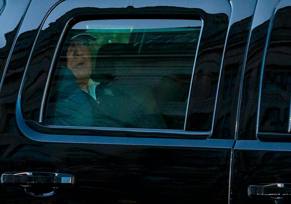 US President Donald Trump watches from the motorcade as he returns to the White House. Source: Getty